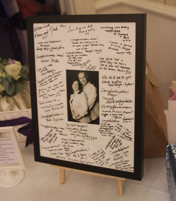 Personalised signing frame signed by wedding guests| Purple themed wedding| Rhiannon & Michael's Real Wedding | Confetti.co.uk