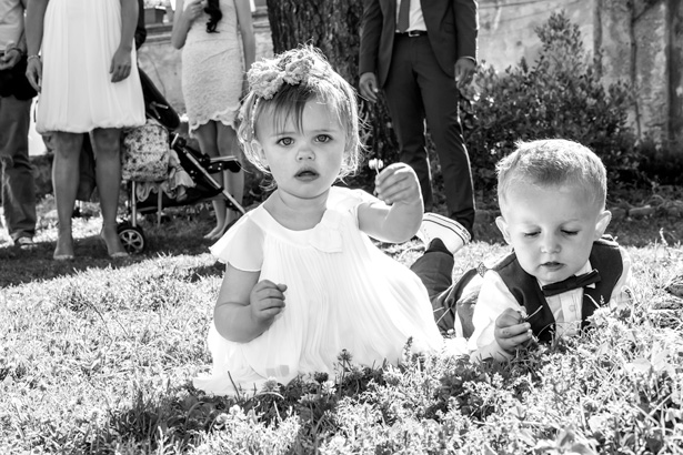 Younger wedding guests playing on the grass | Wedding moments you have to capture | Leanne and Chris's Real Italian Wedding | Confetti.co.uk