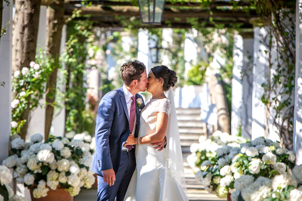 Official wedding shoot by Debbie Sanderson Wedding Photography| Bride and groom kissing in the garden | Wedding moments you have to capture | Leanne and Chris's Real Italian Wedding | Confetti.co.uk