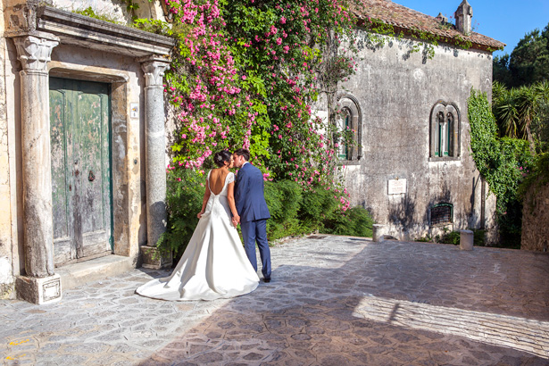 Official wedding shoot by Debbie Sanderson Wedding Photography| Bride and groom kissing on the staircase at Ravello, Italy | Wedding moments you have to capture | Leanne and Chris's Real Italian Wedding | Confetti.co.uk