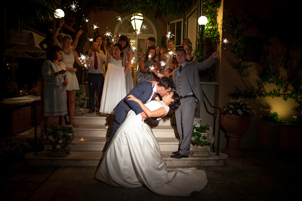 Wedding guests with sparklers | Fun wedding ideas | Leanne and Chris's Real Italian Wedding | Confetti.co.uk