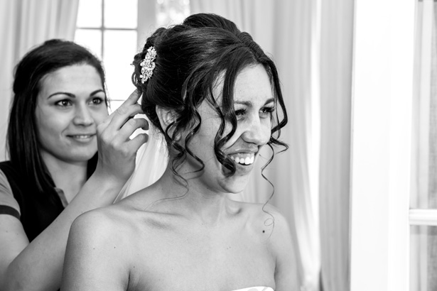 Hair stylist adding diamante clip to the brides hair | Leanne and Chris's Real Italian Wedding | Confetti.co.uk