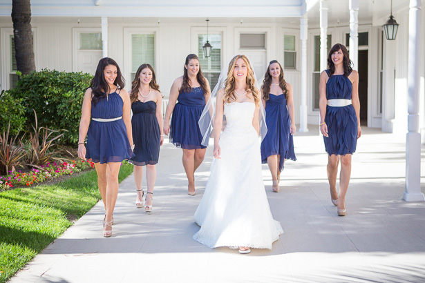The bride in her strapless lace wedding dress | Bridesmaids in royal blue chiffon short dress | Crystal & Giampaolo California Real Wedding |Destination Wedding America | Confetti.co.uk