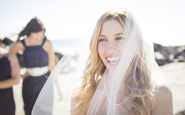 Bride laughing with her bridesmaids on the California beach| Crystal & Giampaolo California Real Wedding |Destination Wedding America | Confetti.co.uk