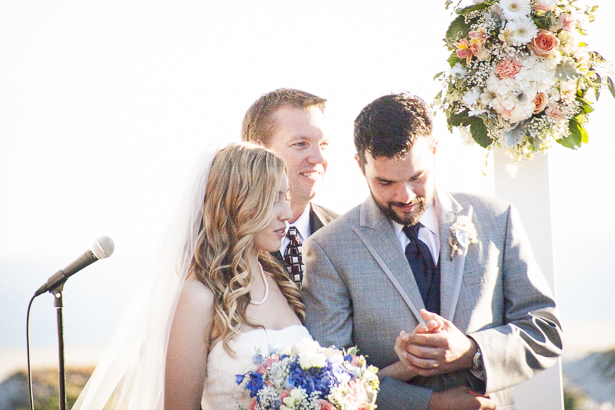 The groom looking and his new wife's wedding ring | Outdoor wedding ceremony ideas | Beach wedding | Crystal & Giampaolo California Real Wedding |Destination Wedding America | Confetti.co.uk