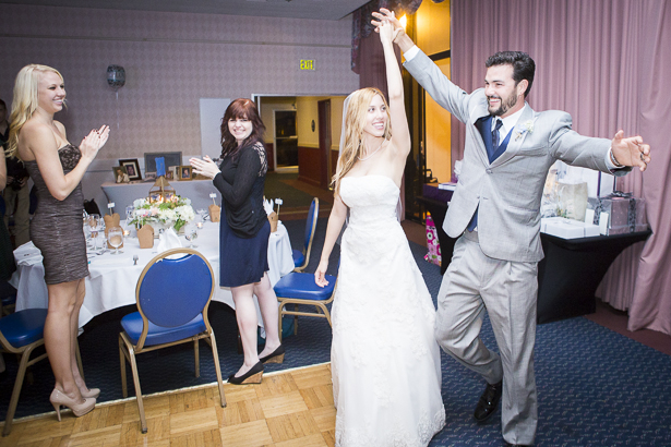 Bride and groom dancing as they enter the reception room | Crystal & Giampaolo California Real Wedding |Destination Wedding | Confetti.co.uk