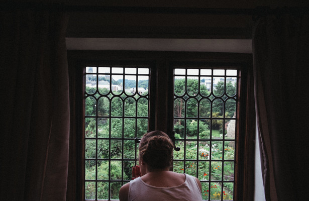 The bride looking out the window in to the garden| Steph and Gary's Real Garden Wedding | Confetti.co.uk