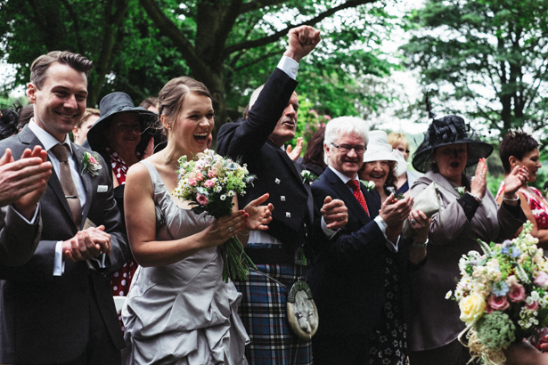 Wedding guests celebrating the marriage| Garden wedding ideas | Steph and Gary's Real Garden Wedding | Confetti.co.uk