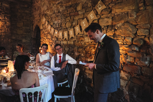 The best man speech | Bride and groom look on as the best man makes his speech | Vintage wedding ideas | Steph and Gary's Real Garden Wedding | Confetti.co.uk