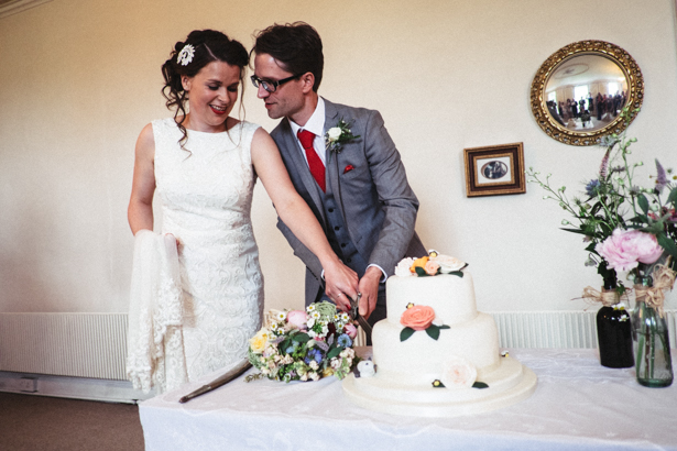 Bride and groom cutting their 2 tiered wedding cake | Vintage wedding ideas | Steph and Gary's Real Garden Wedding | Confetti.co.uk