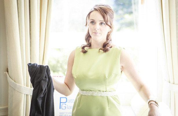 Bridesmaid in her green sleeveless dress and white detailed belt| Nadine and Roberts Real Wedding | Confetti.co.uk