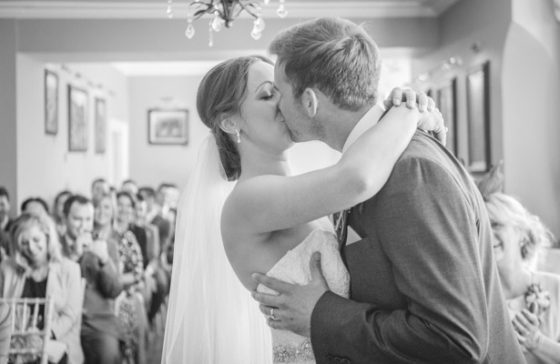 The first kiss as husband and wife | Wedding ceremony at the Deer Park country house | Nadine and Roberts Real Wedding | Confetti.co.uk