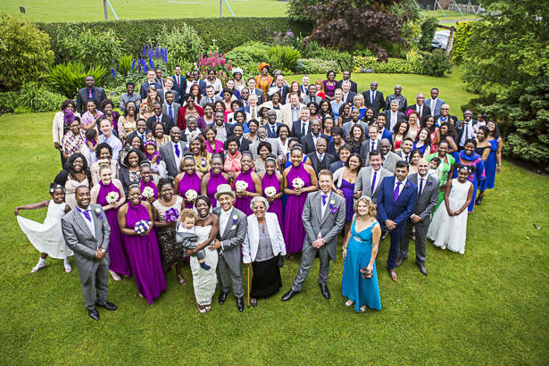 Group shot of the bride and groom with her wedding guests | Precious and Jerald's real wedding | Confetti.co.uk