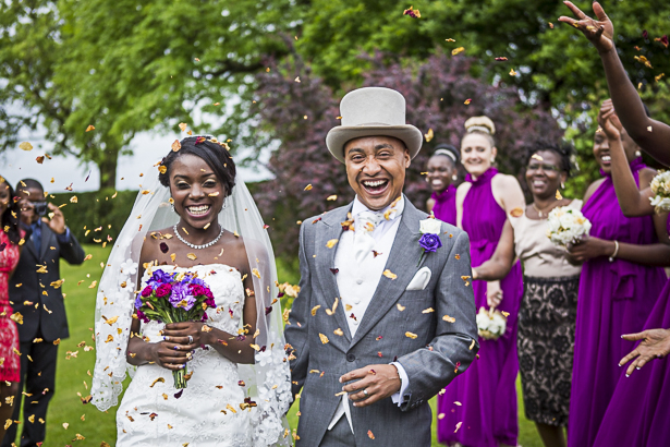 Guests throwing confetti on the bride and groom | Precious and Jerald's real wedding | Confetti.co.uk