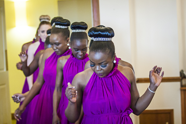 The bridesmaids in purple dancing as they arrive in to the reception  | Bridesmaids making an entrance | Precious and Jerald's real wedding | Confetti.co.uk
