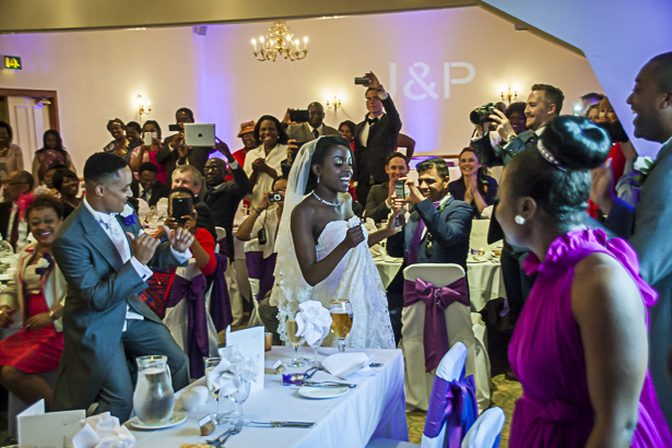 The bride and groom dancing to the top table| Making an entrance | Precious and Jerald's real wedding | Confetti.co.uk