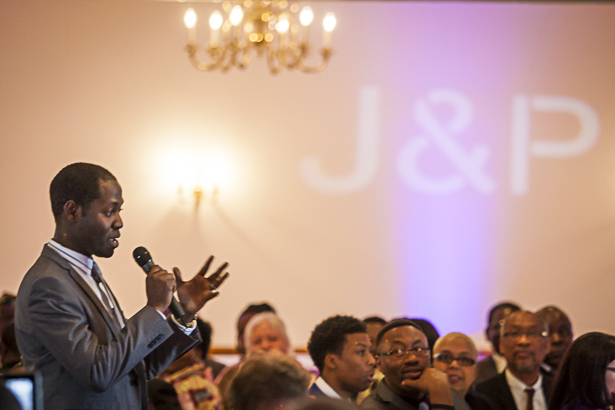 The best mans speech| Bride and grooms initials projected on the wall | Precious and Jerald's real wedding | Confetti.co.uk