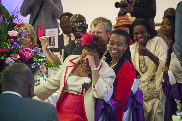 Wedding guests laughing during the wedding speeches | Precious and Jerald's real wedding | Confetti.co.uk