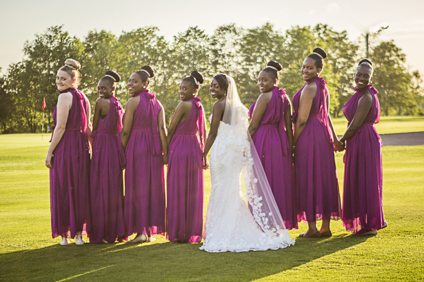 The bride and her bridesmaids in purple halter neck dresses| Precious and Jerald's real wedding | Confetti.co.uk