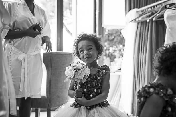 Flower girl in her floral dress, ready for the big day | Precious and Jerald's real wedding | Confetti.co.uk