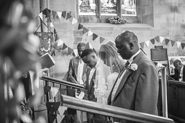 The bride and groom together at the altar for their wedding ceremony | Precious and Jerald's real wedding | Confetti.co.uk