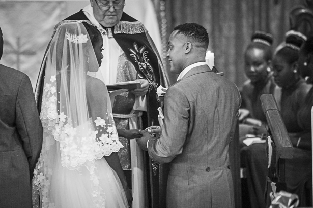 The happy couple exchanging vows | The groom lacing the ring on the brides finger | Precious and Jerald's real wedding | Confetti.co.uk