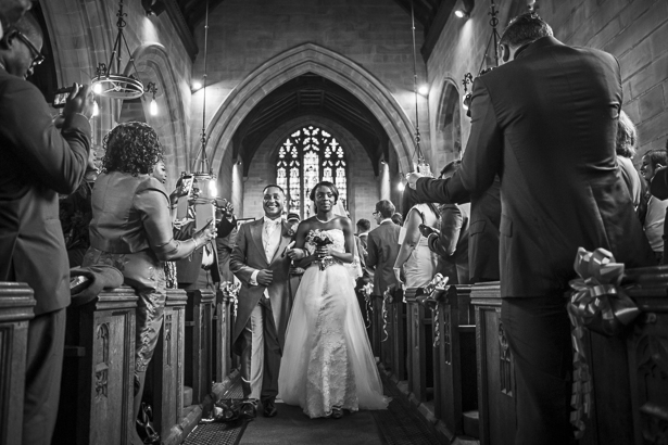 The newlyweds leaving the church | Precious and Jerald's real wedding | Confetti.co.uk