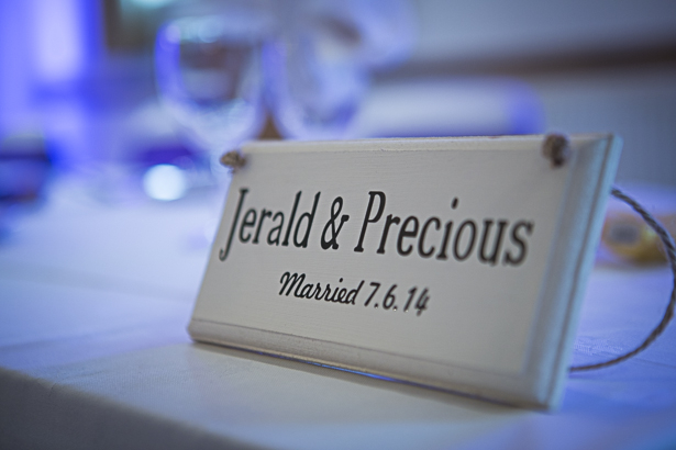 Personalised wedding plaque on the top table | Personalisation wedding ideas | Precious and Jerald's real wedding | Confetti.co.uk