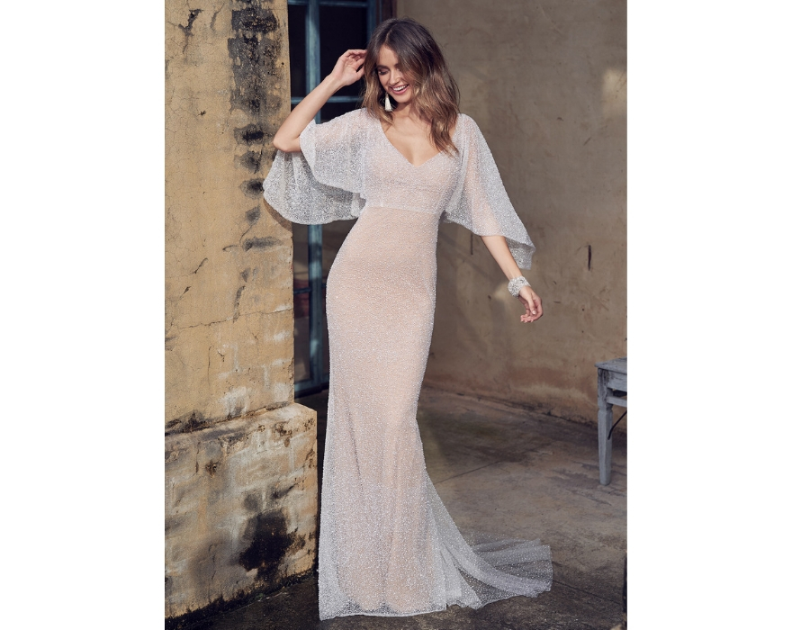 Pale pink wedding dress with draped sleeves