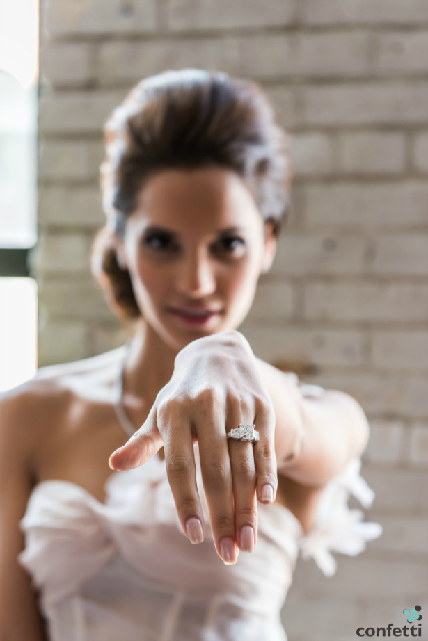 Bride showing her engagement ring | Confetti.co.uk
