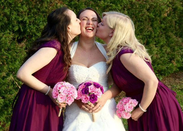Bride and bridesmaids kiss at Jess and Ryan's real wedding  | Confetti.co.uk