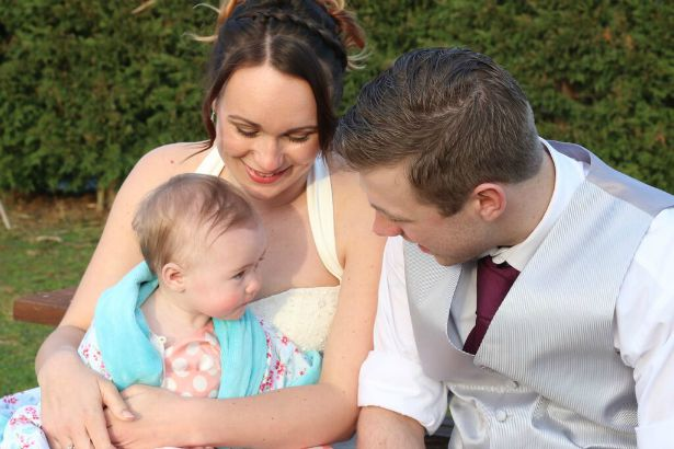 Bride, groom and baby at Jess and Ryan's real wedding | Confetti.co.uk