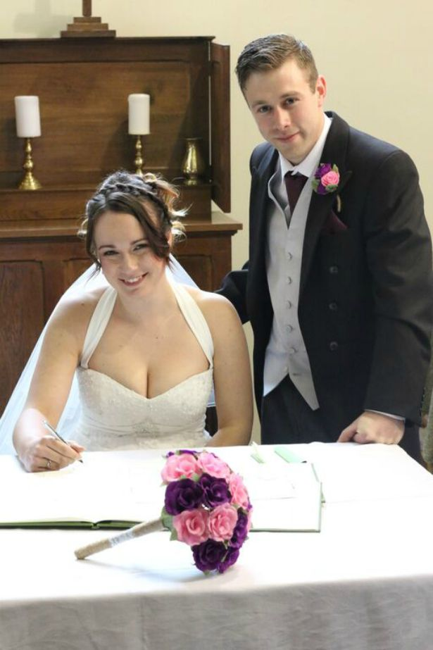 Signing the register at Jess and Ryan's real wedding | Confetti.co.uk