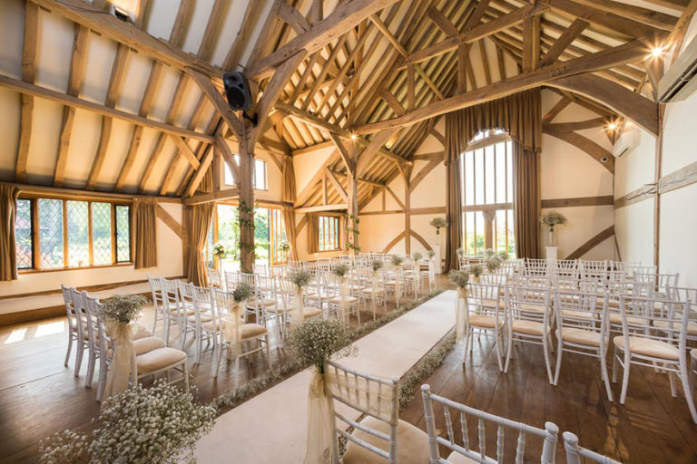 The Music Room Set Up For a Wedding Ceremony at Cain Manor in Surrey - Bijou Wedding Venues - Barn Style Country House Wedding Venue with Baby's Breath Wedding Aisle | Confetti.co.uk