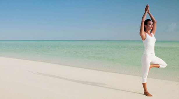 Unwind after the stress of your wedding with a relaxing yoga session on the shore   Confetti.co.uk