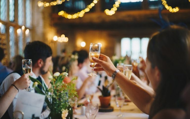 Wedding toasts with raised glasses