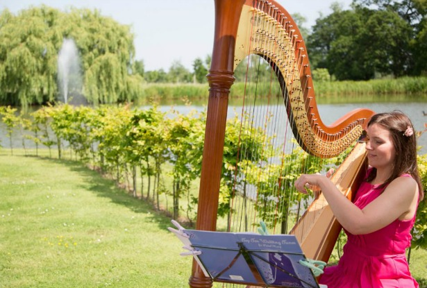 Warble Entertainment harpist playing outside | Confetti.co.uk