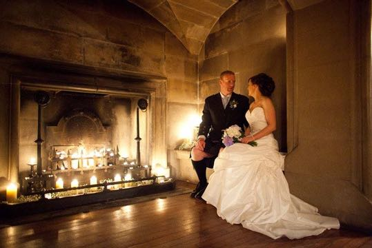 Bride and groom by the open fire at Ackergill Castle Scotland | Confetti.co.uk