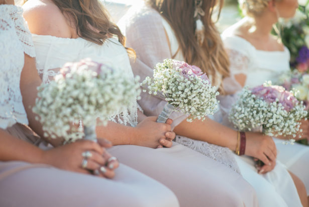 Bridesmaids holding bouquets by Ibiza Flower Shop | Confetti.co.uk