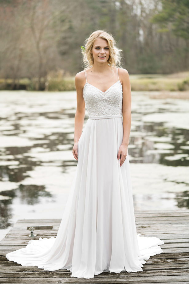Bohemian Style Wedding Dress with lake backdrop by Lillian West | Confetti.co.uk
