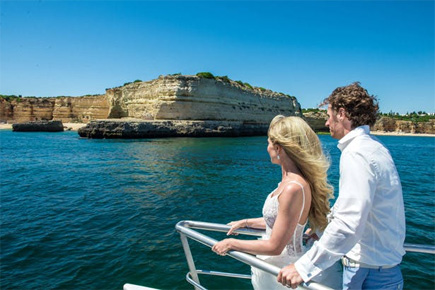 True Blue – Kirsten and Jordis Real Wedding in Portugal By Algarve Wedding Photography - Newly Married Couple Boat Trip | Confetti.co.uk