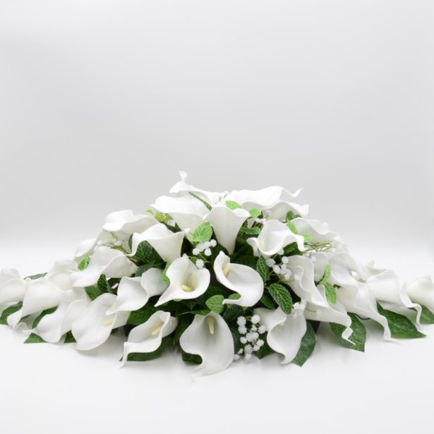 A bridal bouquet of lily artifical flowers by Petals Polly | Confetti.co.uk