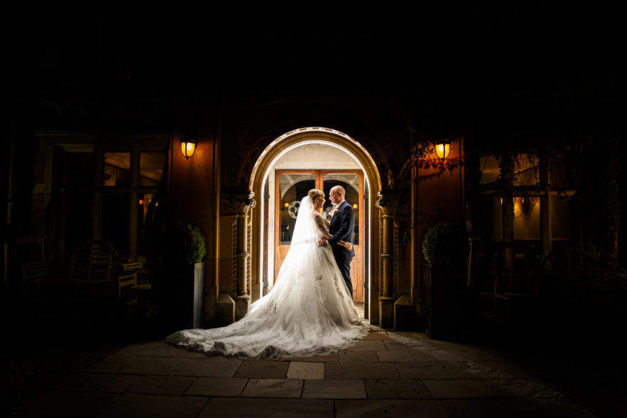 Bride and Groom in doorway at Soughton Hall | Confetti.co.uk