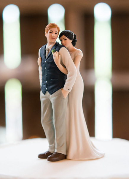 A Sweet Embrace Bride Embracing Groom Couple Figurine Charming Rustic Wedding Cake Topper Inspiration | Confetti.co.uk
