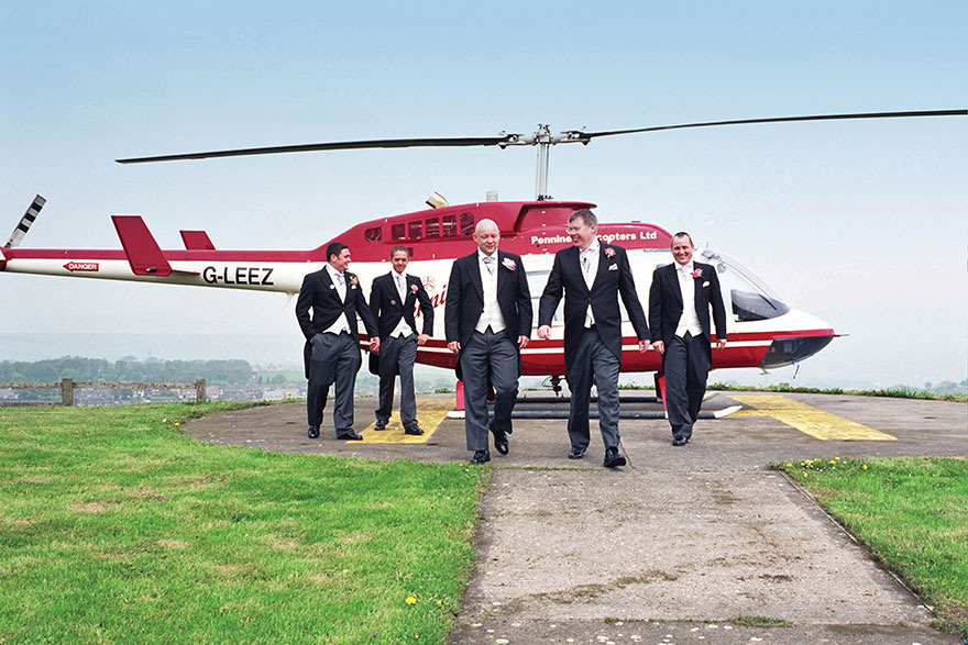 Pennine Manor Helicopter Pad with Groomsmen and Pennine Helicopters Ltd | Confetti.co.uk