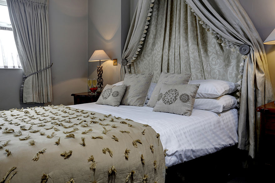 Pennine Manor Wedding Bedroom with Drapes and Champagne | Confetti.co.uk