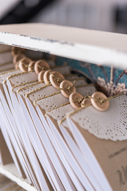 Lace Medley Folded Program Cover with DIY Lace Paper Doilies and Wooden Buttons | Confetti.co.uk