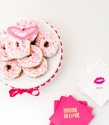 Pink and White Iced Sprinkled Wedding Donuts and Personalised Napkins | Confetti.co.uk