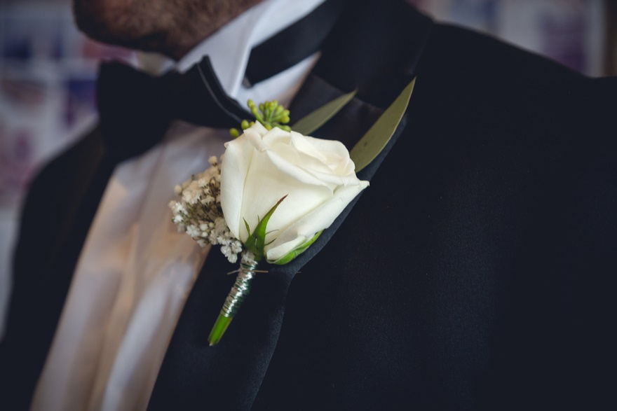 White rose buttonholes for a black tie wedding | Confetti.co.uk
