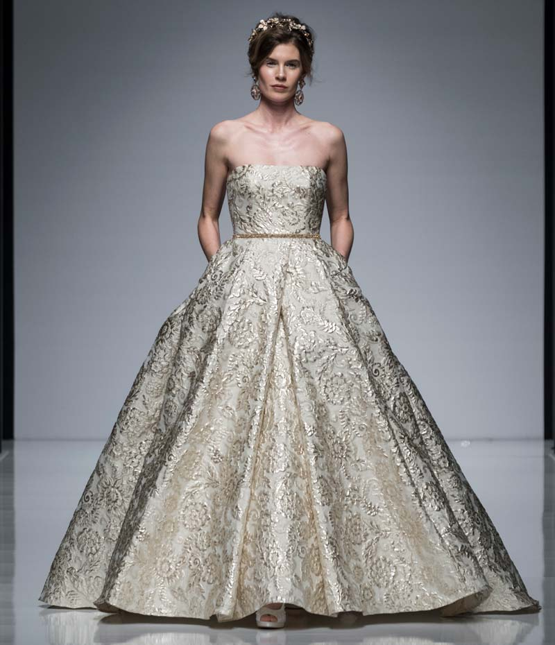 Designer wedding dress with gold textured fabric